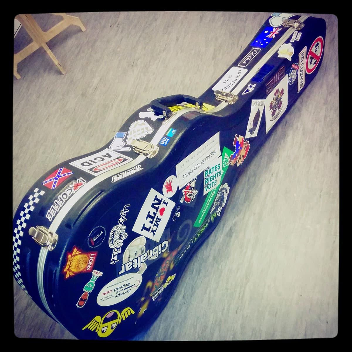 stickered guitar case with stickers from the art of stickers brisbane australia. Black Bedroom Furniture Sets. Home Design Ideas